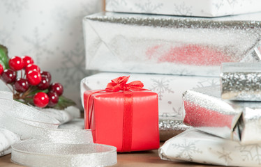 Group Of Wrapped Christmas Gifts, Silver Wrapping Paper, Decorations.