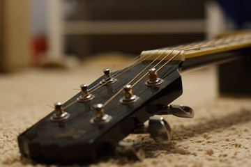 Big black acoustic guitar.