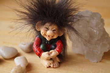 A troll cute with a salt crystal and stones