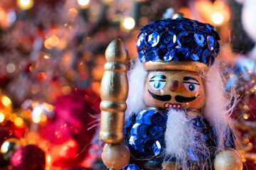 Christmas nutcracker in warm bokeh lights