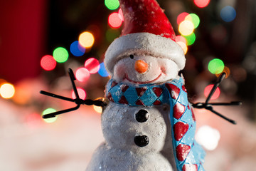 Christmas snowman with bokeh lights closeup