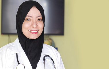 beautiful muslim doctor algerian woman with a beautiful smile and looking to camera