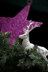 a christmas decoration with a star and a deer