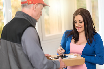 Woman receiving package from delivery man, light effect