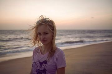 Happy joyful young woman enjoying summer holidays in India on beach vacation. Cute girl smiling at camera.