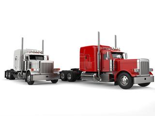 Raging red and bright white 18 wheeler trucks