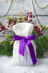 Gift. New Year's bag with gifts on the snow and background with toys. Christmas tree branches