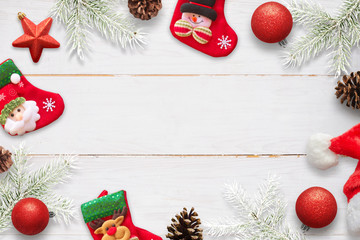 Christmas scene with decorations on white wooden table. Socks waiting for Santa Claus gifts.