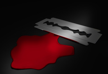 Razor blade next to blood puddle - Suicide concept
