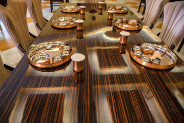 Served tables at restaurant with metal tableware