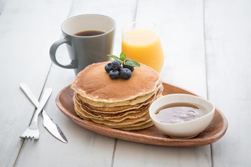 isolated blue berry pancake with  syrup and drink