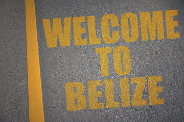asphalt road with text welcome to belize near yellow line.