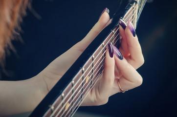Spoed Fotobehang Manicure girl playing the guitar