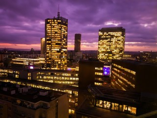 Prague skyscrapers in blue hour with purple sky. Modern office architecture.