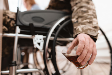 The veteran in a wheelchair is depressed. He has problems with alcohol.