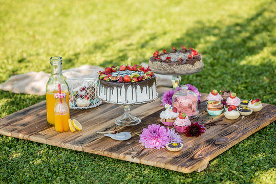 selection of sweet cakes in a garden picnic birthday celebration