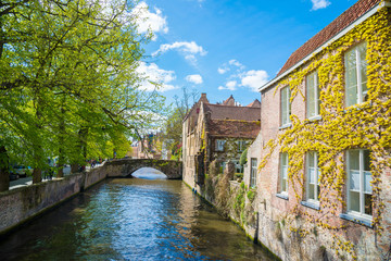 Bruges cityscape with water canal and Meestraat Bridge, Belgium