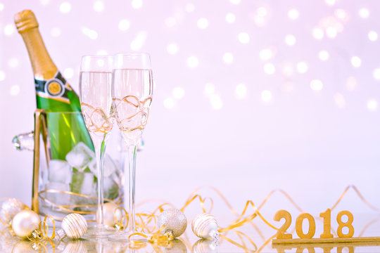 New Year Celebration with Champagne Glasses and a Bottle 2018