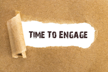 The text Time To Engage appearing behind torn brown paper