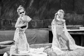 village children play in the courtyard in vogue