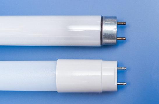 Led light tube vs fluorescent light tube on blue background