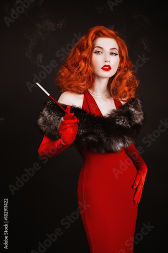Red Haired Woman With Curly Hair In Red Dress And Long