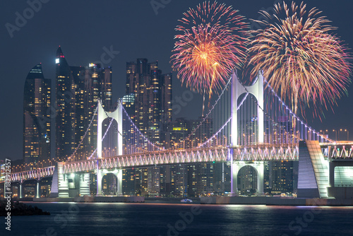 new year fireworks show at gwangan bridge with busan city in background at busan south