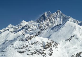 two snowed peaks in Switzerland