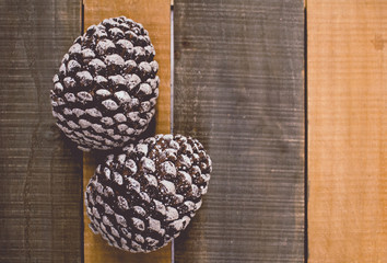 Pines cones on wood Christmas background