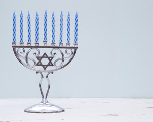 Hanukkah Menorah with a Simple Blue Background on a Distressed Wooden Table