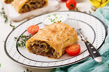 Appetizing strudel with minced beef, onions and herbs