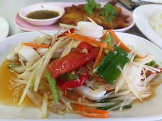 Papaya salad is popular in Thailand.