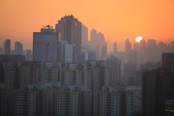 horizon sunset in hong kong with housing background