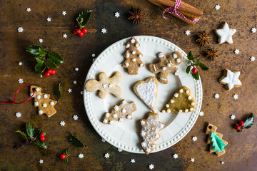 Homemade Christmas gingerbread cookies on vintage background.