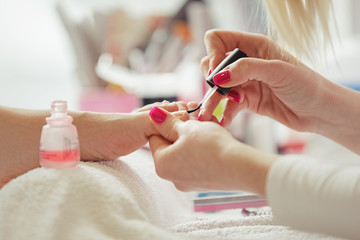 Nail Polishing. Pedicure Treatment. Close up.