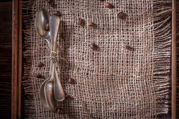 Old burlap doily and coffee beans as background