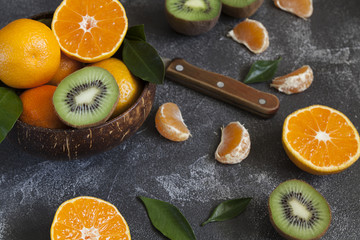 juicy mandarins and kiwi. Citrus. orange. fruit harvest