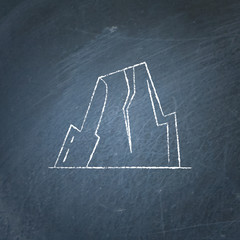 Mountain with ledges icon on chalkboard