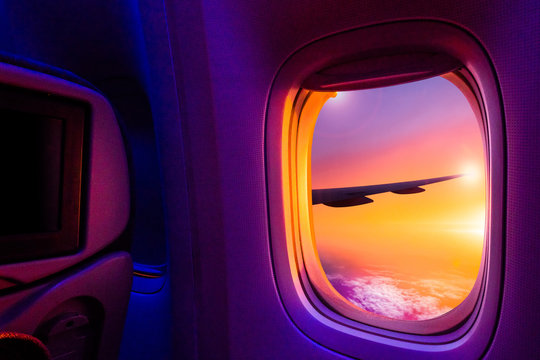 Beautiful scenic view of sunset through the aircraft window. Image save-path for window of airplane.