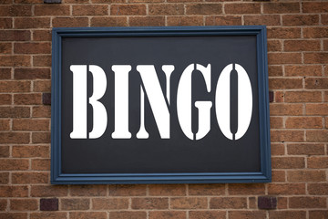 Conceptual hand writing text caption inspiration showing announcement Bingo. Business concept for Lettering Gambling to Win Price Success written on frame old brick background with copy space