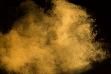 Yellow theatrical smoke on stage during a performance or show.