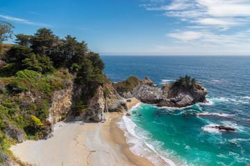 Fine beach and falls, Julia Pfeiffer beach and McWay Falls, Big Sur. California, USA.