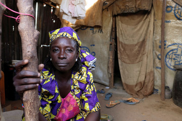 Zainab Bukar, an internally displaced person living in Bama camp, Nigeria, poses for a picture in her shelter