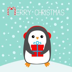 Merry Christmas Candy cane. Penguin on snowdrift. Headphones earphones hat. Gift box. Cute cartoon kawaii funny animal character. Flat design. Winter blue snow background. Greeting card.