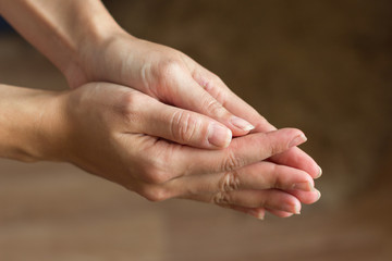 Hands are connected close-up. A gesture of help, supplication, repentance.