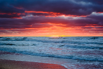Scenic colorful sunset with amazing clouds over the Baltic sea. Poland.