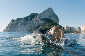 Diver swimming in splashing water