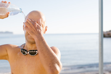 Man taking shower after swimming