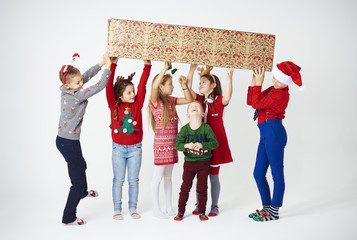Playful children having a fun at christmas .