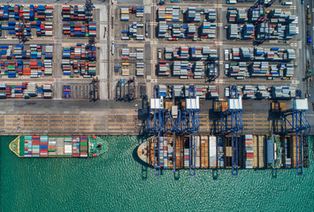 container ship in import export and business logistic.By crane ,Trade Port , Shipping, cargo to harbor, Aerial view, Top view.